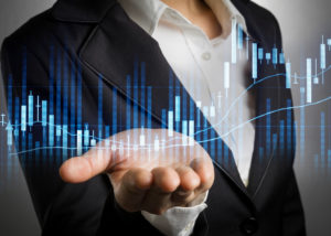 business woman in black suit open palm hand for show stock graph analized.